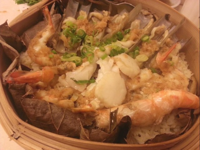 Steamed Seafood Rice in Lotus Leaf